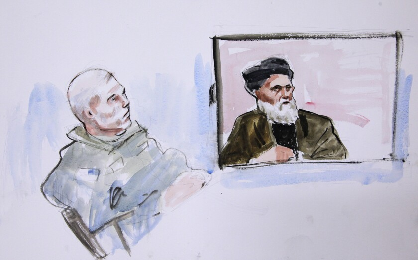 Staff Sgt. Robert Bales looks on as Haji Mohammed Naim testifes from Afghanistan in this courtroom drawing.