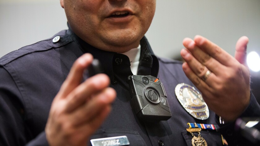 A Los Angeles Police Department sergeant demonstrates a body camera in 2014.