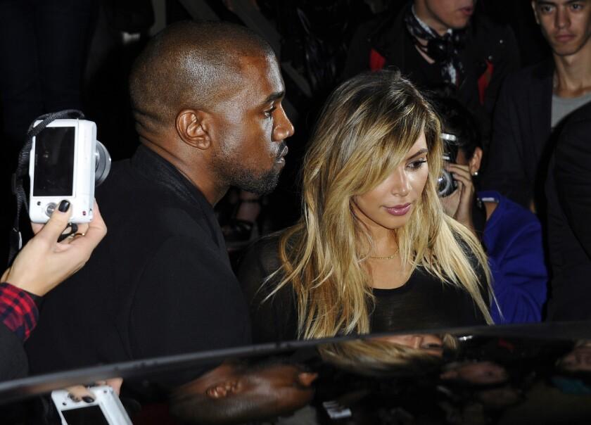 Kanye West, left, and Kim Kardashian last year in Paris.