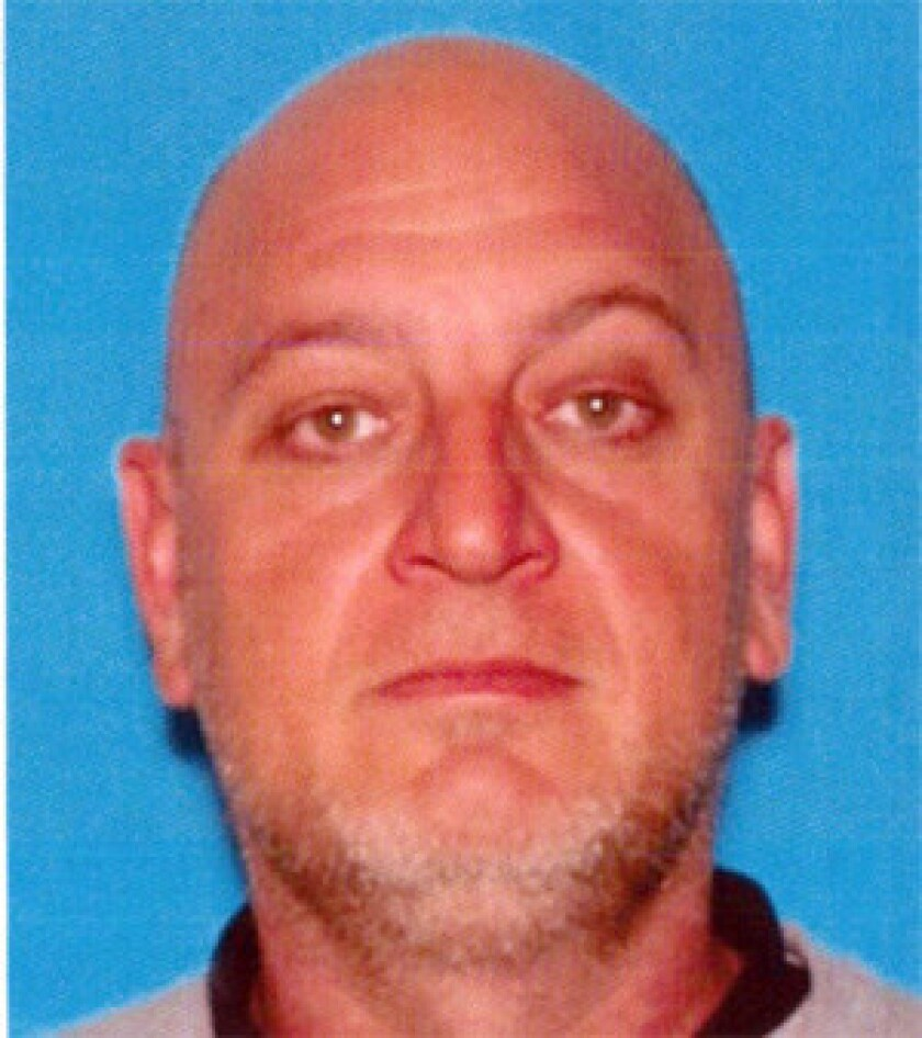The body of Christopher Waters, 42, was discovered April 23 in a burning SUV in Rancho Palos Verdes. Two people have been arrested in connection with his slaying.