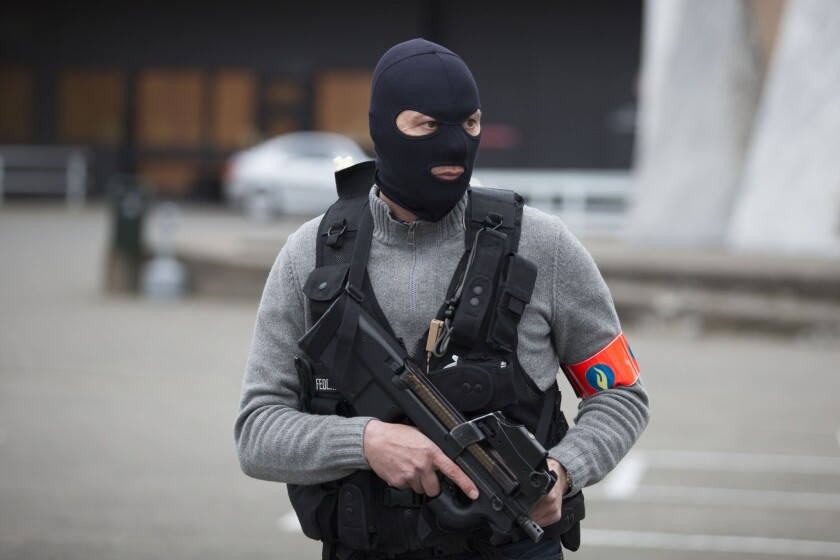 A special forces police officer awaits a convoy expected to be carrying captured fugitive Salah Abdeslam to the federal penitentary in Bruges, Belgium, on March 19, 2016.