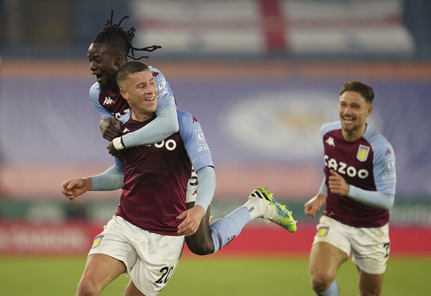 Aston Villa's Ross Barkley, bottom left, celebrates after scoring during the English Premier League soccer match between Leicester City and Aston Villa at the King Power Stadium in Leicester, England, Sunday, Oct. 18, 2020. (Jon Super, Pool via AP)
