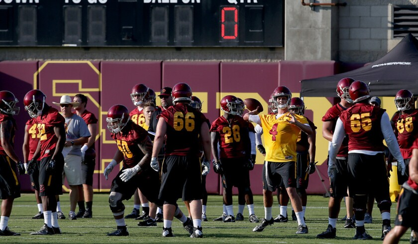 USC football players work out at Howard Jones Field on the campus of USC.