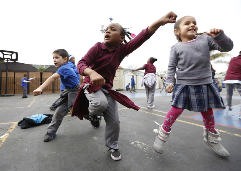 Students at Children of Promise Preparatory Academy in Inglewood dance to honor their music teacher, Benny Golbin, after he was killed in a car crash.