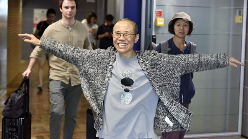 Liu Xia, the widow of Chinese Nobel Peace Prize laureate Liu Xiaobo, smiles as she arrives at the Helsinki International Airport in Finland on Tuesday.