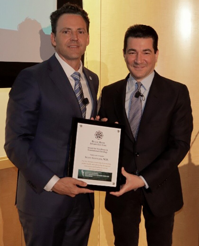 "4th District San Diego County Supervisor Nathan Fletcher (left) presents Dr. Scott Gottlieb with the Duane Roth Achievement Award and proclaims Feb. 20, 2020 as ""Scott Gottlieb Day."""