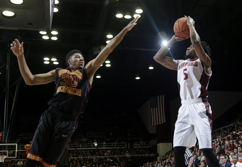 Stanford guard Chasson Randle (5) shoots over Southern California guard Elijah Stewart (30) during the second half of an NCAA college basketball game Sunday, Feb. 8, 2015, in Stanford, Calif. Stanford won 70-62. (AP Photo/Marcio Jose Sanchez)
