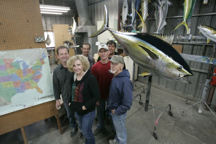 The staff at Lyons and O'Haver Taxidermists are, left, Jamie Lyons and his wive Delores, Hughie Lyons, right front, Mike O'Haver, left rear, Lance Lyons, center with white hat, and Captain Mike Lackey, right rear who is the skipper of the sport fishing boat Vagabond, who was running the boat when t