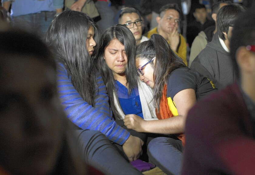 Miriam Lopez, left, Faby Jacome and Dulce Saavedra are brought to tears as they watch President Obama's immigration address. His executive action created a pathway of opportunity for millions -- as well as a new opening for scam artists.