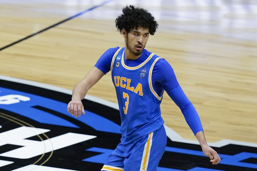 UCLA guard Johnny Juzang runs up court after scoring against Michigan in the Elite Eight.