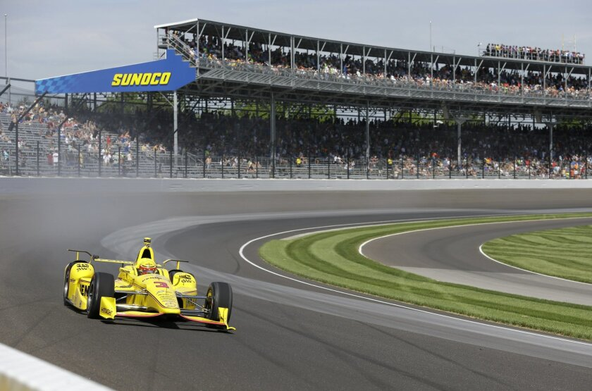 Helio Castroneves, of Brazil, drives through turn one during the final practice session for the Indianapolis 500 auto race at Indianapolis Motor Speedway in Indianapolis, Friday, May 27, 2016. (AP Photo/Michael Conroy)