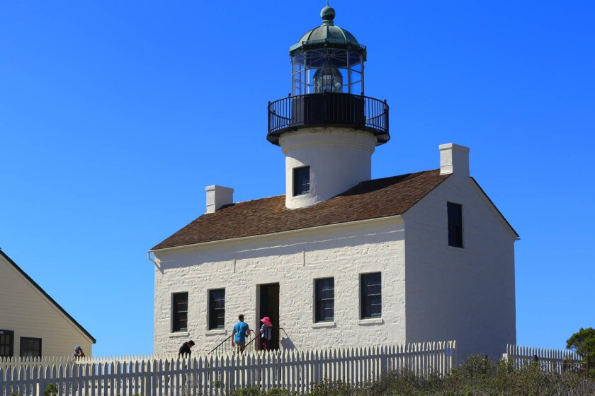 Visitors walk about the historical high house at the Cabrillo National Park during the celebration of the 28th annual Whale Watch & Intertidal Festival.
