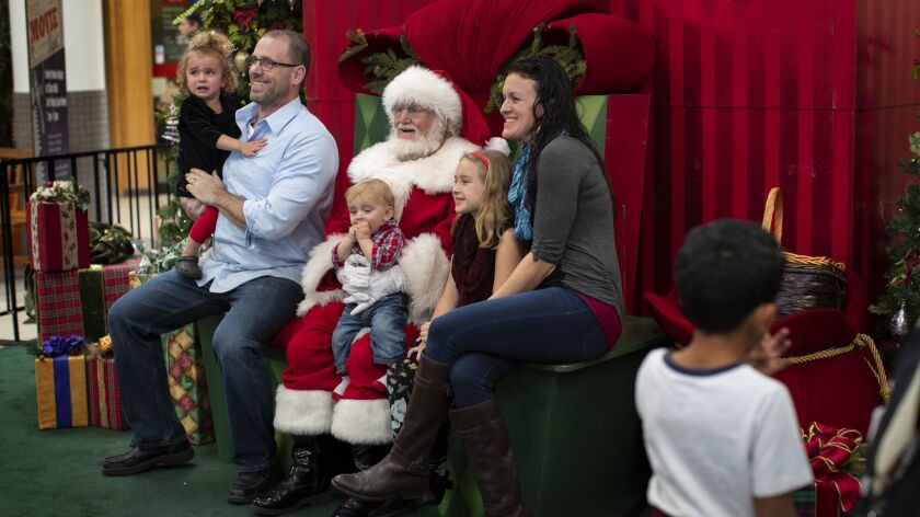 CHICO, CA - DECEMBER 1, 2018: The McCluskey family of Chico get a photo taken with Santa at the Chic