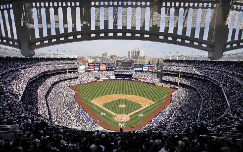 Until Cleveland's nine-run seventh inning, the real star was the new ballpark, evoking the original Yankee Stadium design. (Seth Wenig / Associated Press)