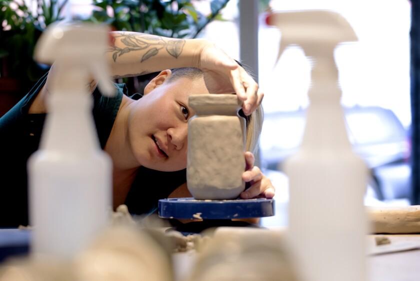 Artist Stephanie Shih works on a ceramic piece