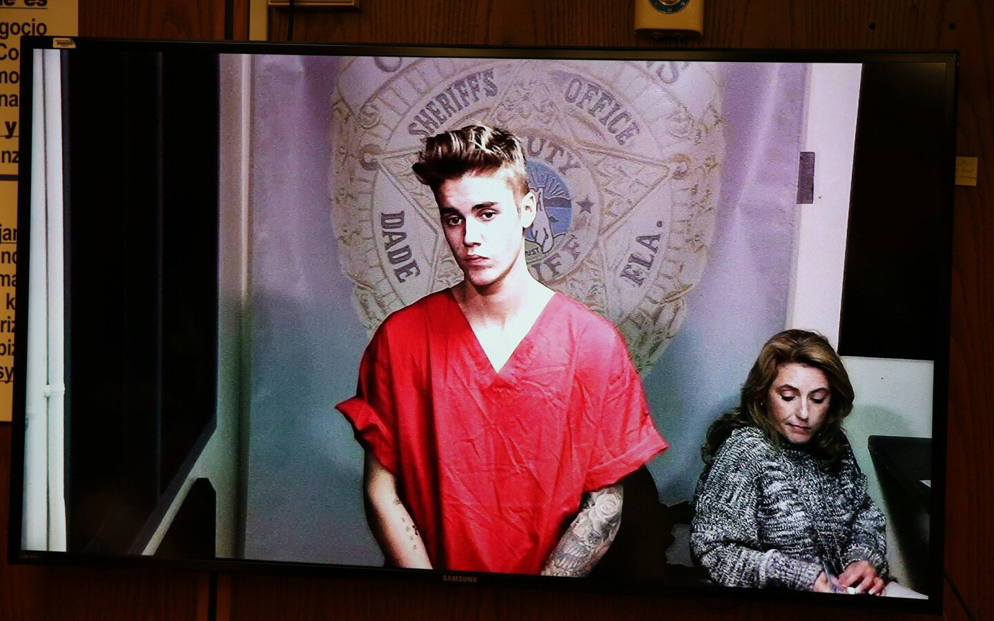 Justin Bieber appeared briefly in front of Judge Joseph Farina, via video, clad in red jail-issued scrubs at Miami-Dade Circuit Court in Florida. Bond was set at $2,500.