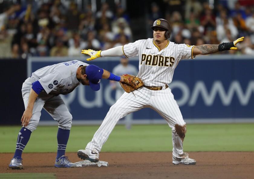 Manny Machado calls himself safe after stealing second base