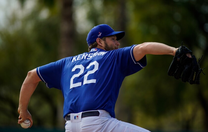 Dodgers pitcher Clayton Kershaw delivers during live batting practice before a spring training game against the Chicago Cubs on Sunday.