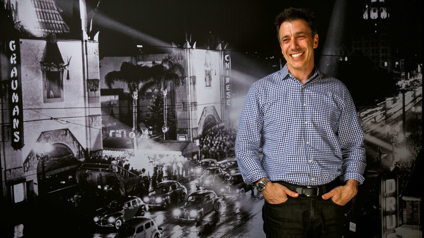 Fandango President Paul Yanover in front of a historical photo of the TCL Chinese Theatre, in Los Angeles, Calif.