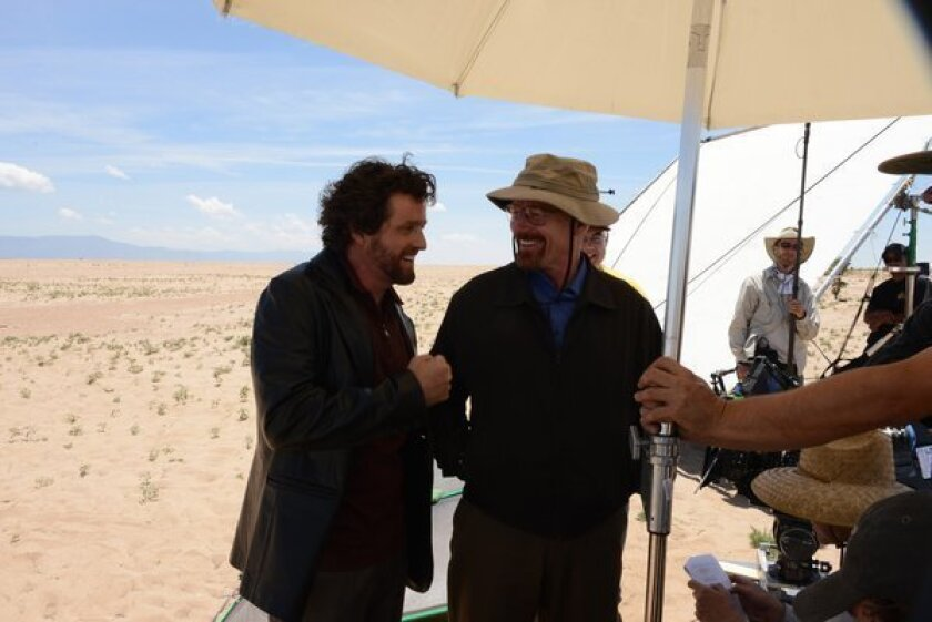 """Actors Louis Ferreira and Bryan Cranston on the set of the AMC series """"Breaking Bad,"""" which films in New Mexico."""