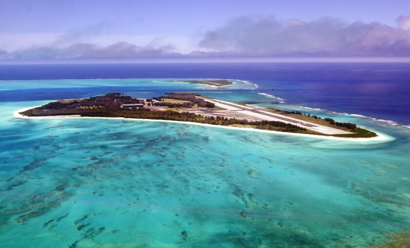 An aerial view of the 2.4-square-mile Midway Atoll. A United Airlines flight from Honolulu to Guam made an emergency landing at Midway after plane had mechanical issues.