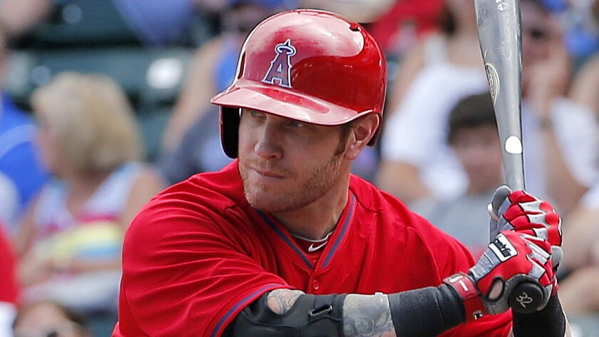 Angels outfielder Josh Hamilton takes a high fastball during a March 2014 exhibition game against the Chicago Cubs in Mesa, Ariz.