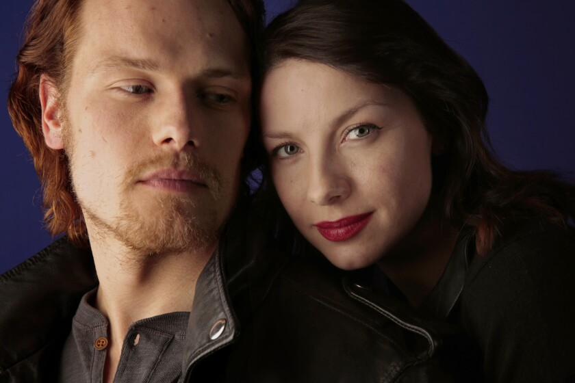 "Sam Heughan and Caitriona Balfe portray Jamie and Claire in Starz's ""Outlander."""