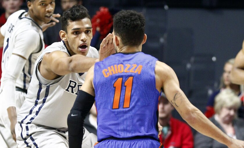 In this Jan. 16, 2016,  photo, Mississippi forward Sebastian Saiz (11) defends against Florida guard Chris Chiozza (11) in an NCAA college basketball game in Oxford, Miss. Saiz, barely three weeks removed from eye surgery to repair a partially detached retina, returned to the court Tuesday, Feb. 9