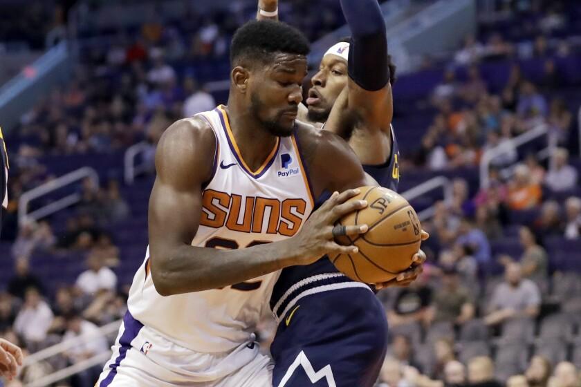 APphoto_Nuggets Suns Basketball