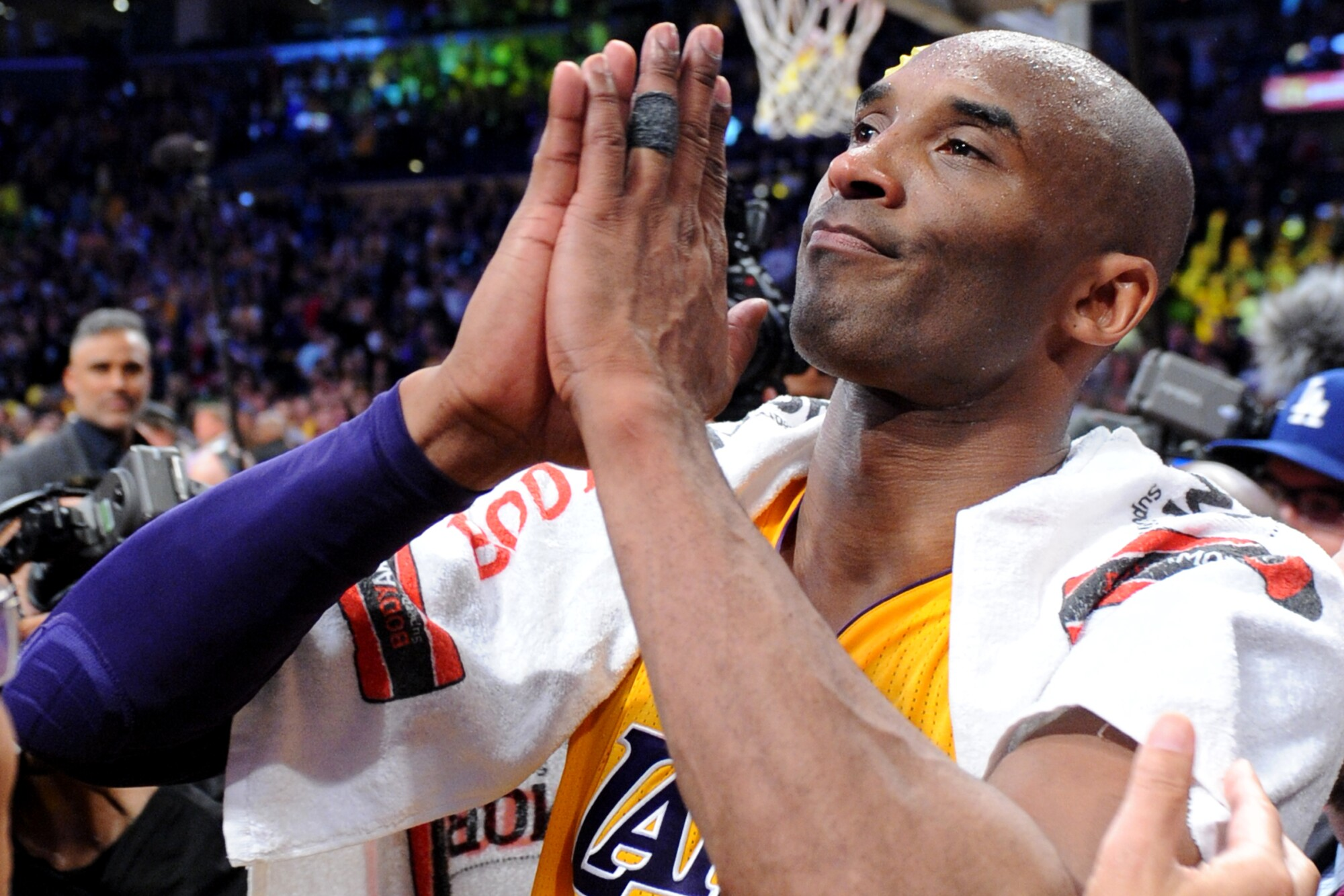 Lakers star Kobe Bryant pays homage to the crowd at Staples Center following the final game of his career on April 13, 2016.