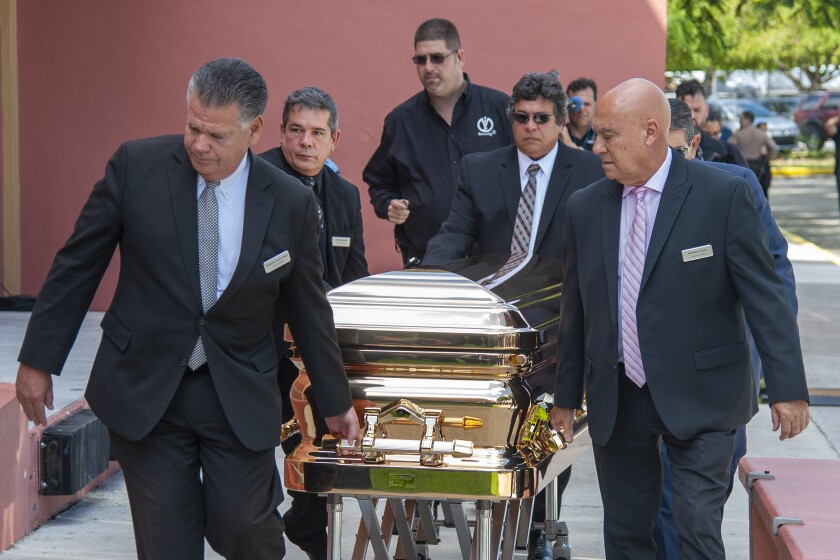 The casket with the remains of Mexican singer Jose Jose is wheeled into the Miami Dade County Auditorium for a public viewing Sunday, October 6, 2019 in Miami. (AP Photo/Gaston De Cardenas)