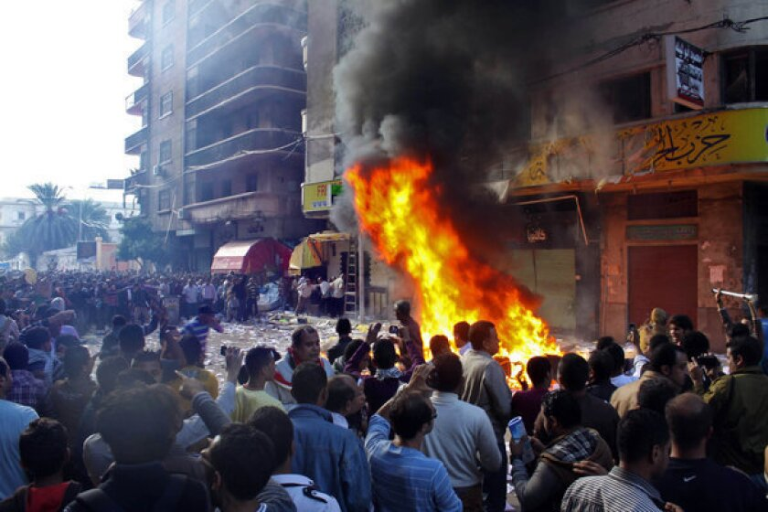 Clashes erupt, offices ablaze after Egypt president expands power