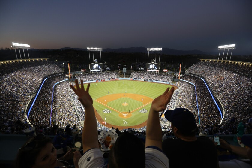 Dodgers fans sitting in the top deck at Dodger Stadium cheer during Game 2 of the 2017 World Series.