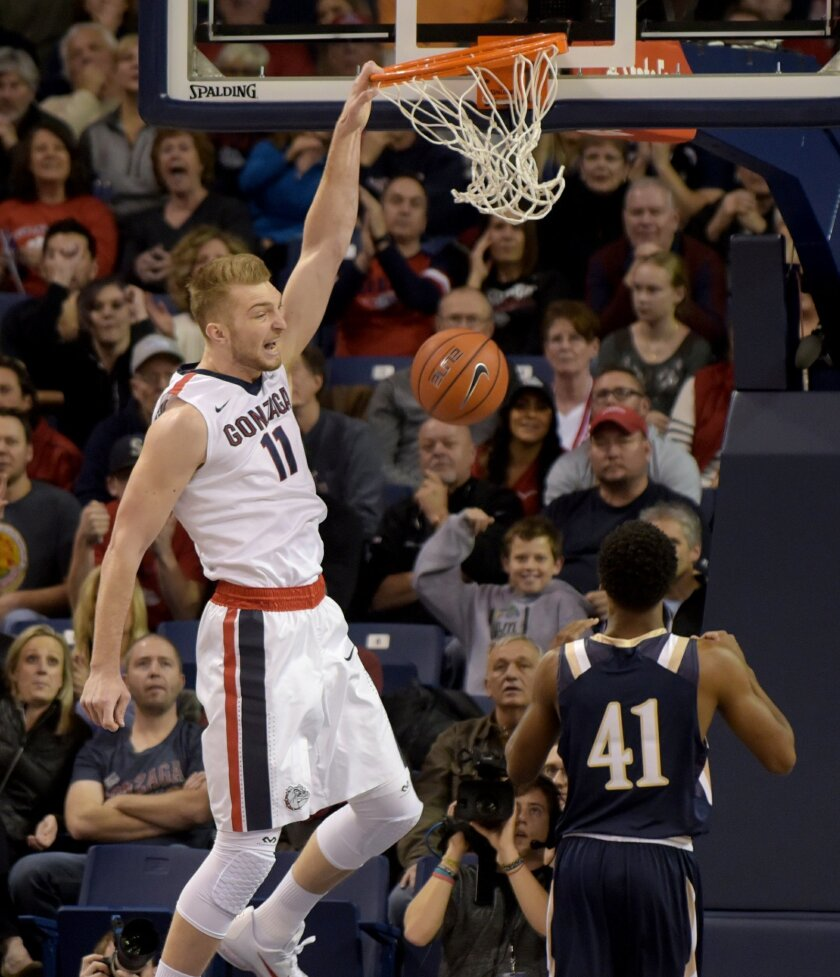 FILE - In this Nov. 21, 2015, file photo, Gonzaga's Domantas Sabonis (11) dunks over Mount St. Mary's BK Ashe (41) in the first half of an NCAA college basketball game, in Spokane, Wash. This year's Battle 4 Atlantis tournament bracket is anchored by three Top 25 teams led by No. 10 Gonzaga, along with No. 19 Connecticut and new addition Texas A&M at No. 25. (AP Photo/Rajah Bose, File)