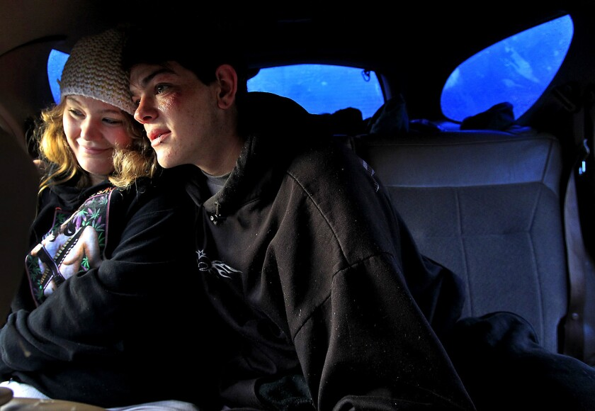 """Lea Glynn and boyfriend Cody Wertz wait for checkout time after spending the night in his station wagon in a """"safe parking"""" lot in Sonoma County."""