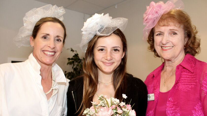 Fascinating in their fascinators are Club President Marianne Jennings, on right, her daughter Tamara