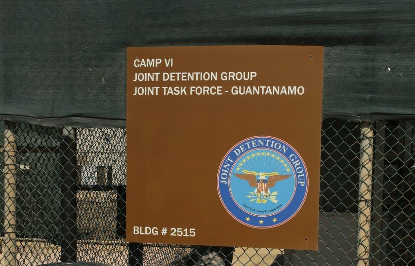 In this Feb. 2, 2016 photo, a sign for Camp 6 is posted outside the U.S. detention center at Guantanamo Bay, Cuba. President Barack Obama has refused to send any suspected terrorists captured overseas to the detention center at Guantanamo Bay. But if the U.S. starts seizing more militants in expanded military operations, where will they go, who will hold them and where will they be tried? (AP Photo/Ben Fox)