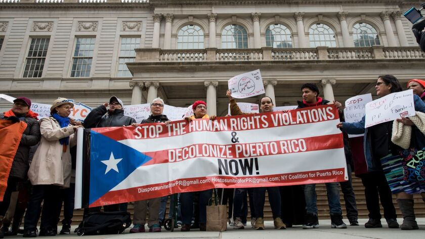 Activists rally in support of Puerto Rican families displaced by Hurricane Maria April 19 in New York City.