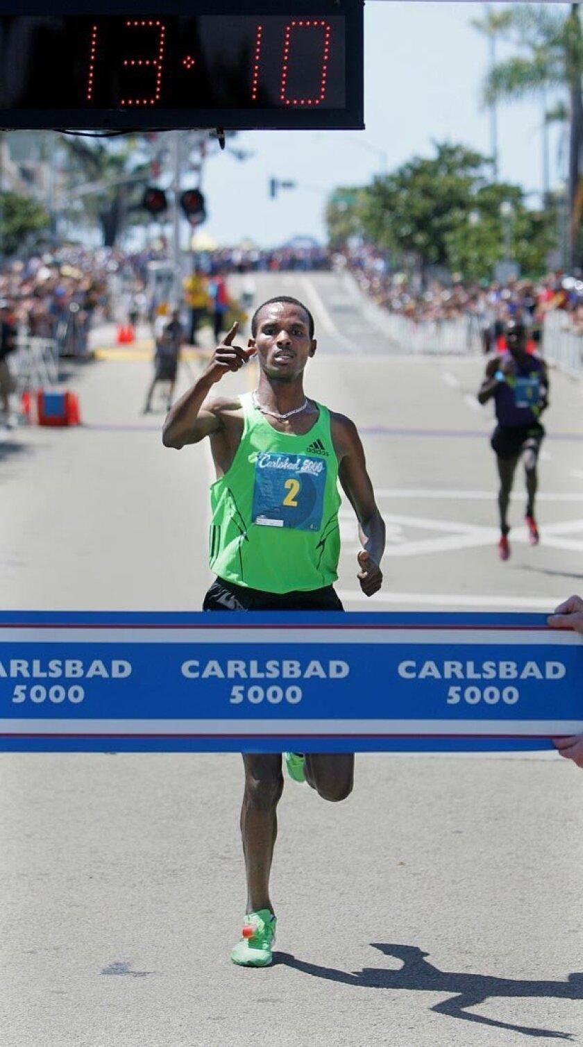 Elite Men racer Dejen Gebremeskel of Ethiopia wins.