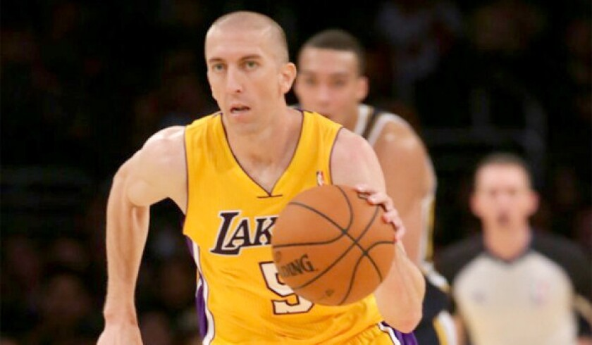 Steve Blake brings the ball up the floor during the Lakers' 108-94 win over the Utah Jazz in a preseason exhibition game Tuesday.