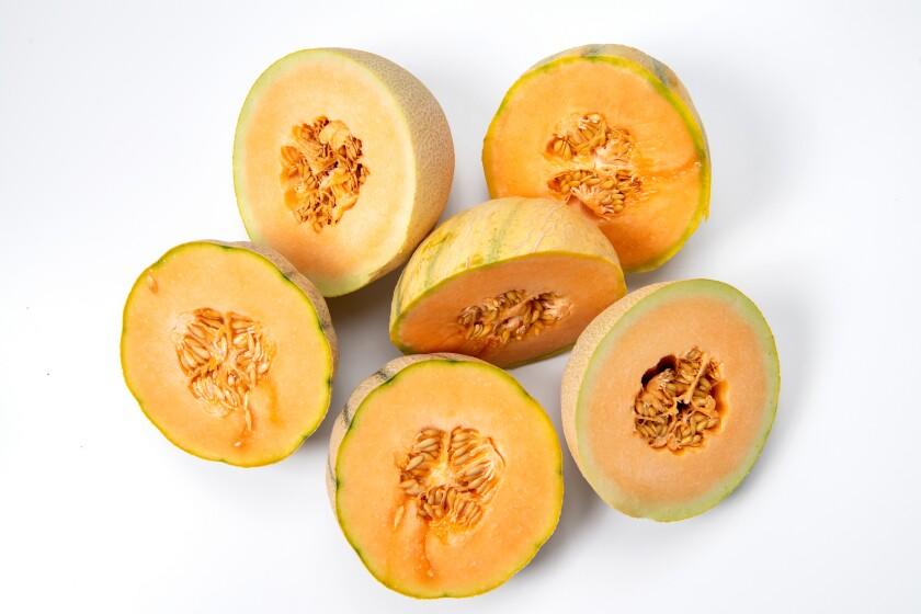 Halved Charentais, cantaloupe and sugar kiss melons.