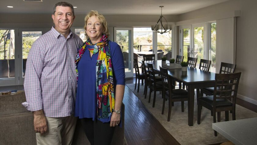 Garo Megerian, left, and his wife, Annette, right, from Pennsylvania, are spending some off time in their La Jolla vacation home that they bought last year and rent out on a short-term basis when they're not there.