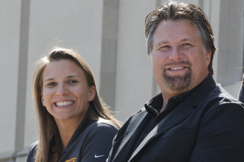 Driver Simona de Silvestro and car owner Michael Andretti smile during a news conference Thursday, April 2, 2015, at the The Franklin Institute in Philadelphia. Andretti announced that the Swiss-born de Silvestro will drive the No. 29 TE Connectivity Honda in the Indianapolis 500 race. (AP Photo/Matt Rourke)