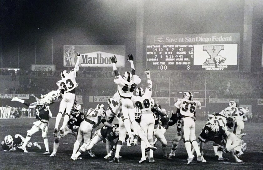 BYU kicks the extra point for its 46-45 victory over SMU in the 1980 Holiday Bowl.