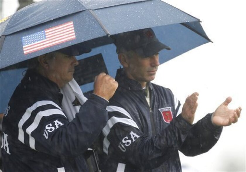 U.S. team captain Corey Pavin, right, and unidentified team member reacts on the 2nd green after their team made par during the 2010 Ryder Cup golf tournament at the Celtic Manor golf course in Newport, Wales, Friday, Oct. 1, 2010. (AP Photo/Alastair Grant)