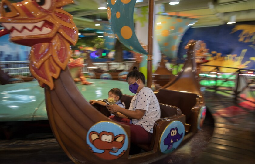 Visitors enjoy themselves at Yoyo Land, an indoor amusement center in Bangkok, Thailand, Tuesday, June 16, 2020. Daily life in the capital resumes to normal as the government continues to ease restrictions related to running business and activities that were imposed weeks ago to combat the spread of COVID-19. Thailand reported no local transmissions of the coronavirus in the past 3 weeks. (AP Photo/ Gemunu Amarasinghe)