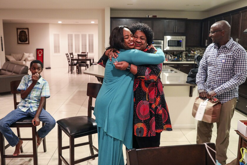 L, Dr. Akilah Weber,  hugs her Mom, Shirley Weber after hearing positive election results