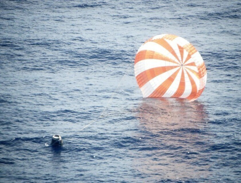 The Dragon capsule delivered 882 pounds of supplies to the space station this month and returned with 1,673 pounds of cargo that included damaged equipment and scientific experiments. The unmanned capsule, which was launched Oct. 7, splashed down about 250 miles west of the Southern California coast.