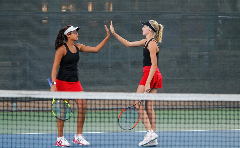 Canyon Crest's Lyna Fowler (right) and doubles teammate Asha Gidwani cheer a point in last year's section final.