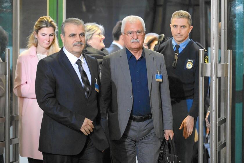 Members of Syria's main opposition group arrive for talks in Geneva.